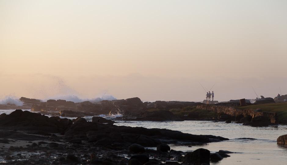 Fishermen standing at Port Edward´s Sea